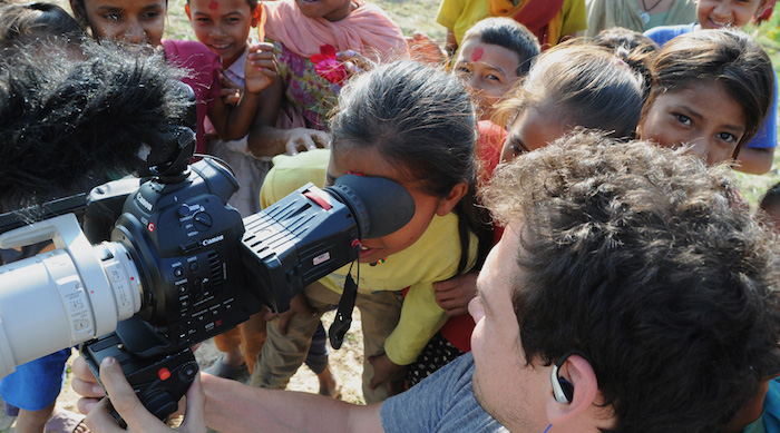 Patrick-with-camera-and-Nepal-kids-1